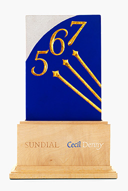 Crest of Portland Stone section of corresponding Sundial, set in a specially-carved freestanding wooden presentation frame.