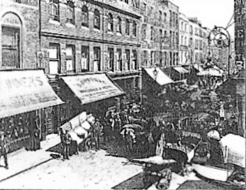 1895 Earlham Street (West), showing the lively street market activities, traditional shopfronts and decorative street furniture.