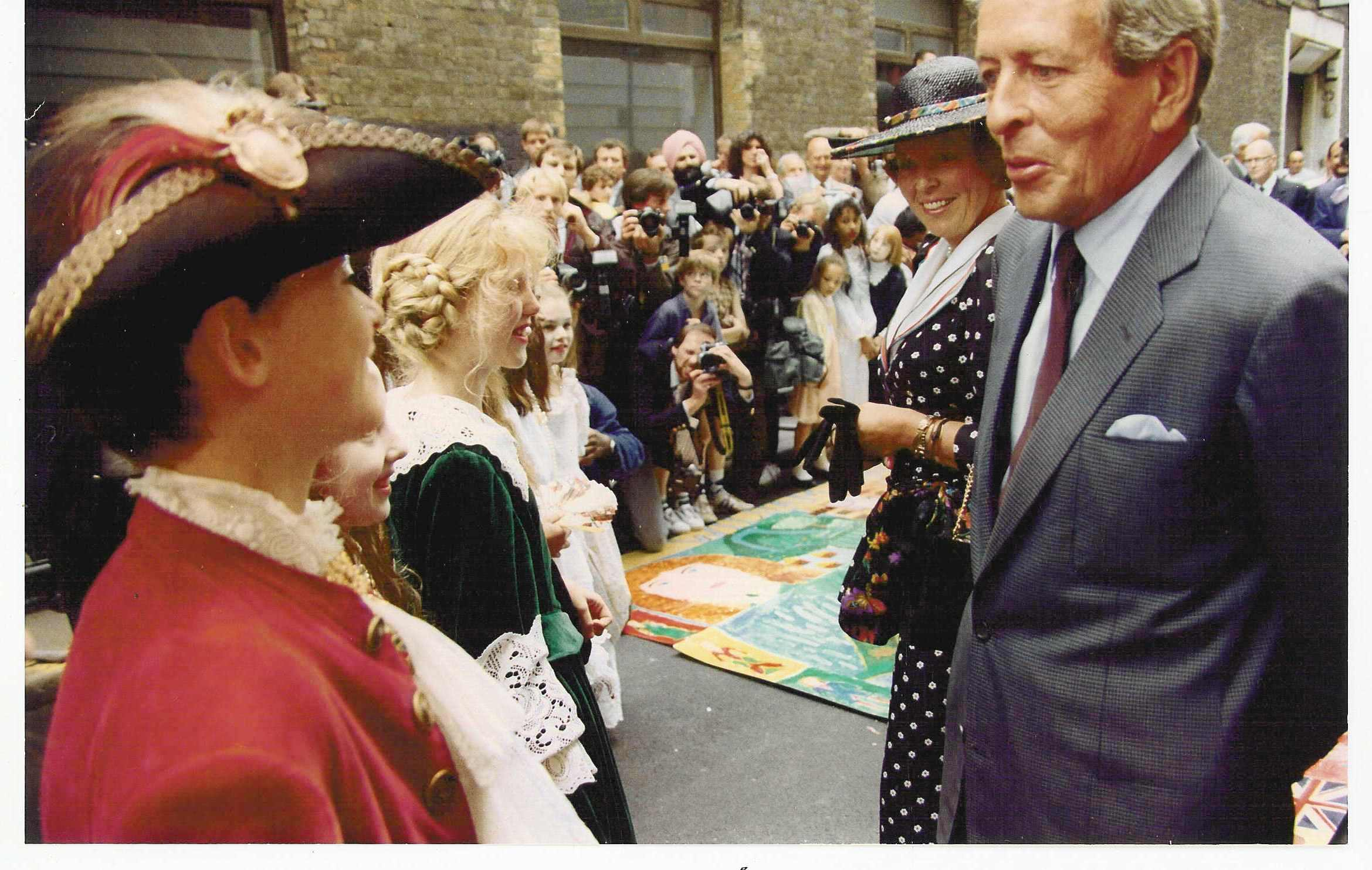 Queen Beatrix and Prince Claus congratulate the pupils of St Clements Danes Primary School.