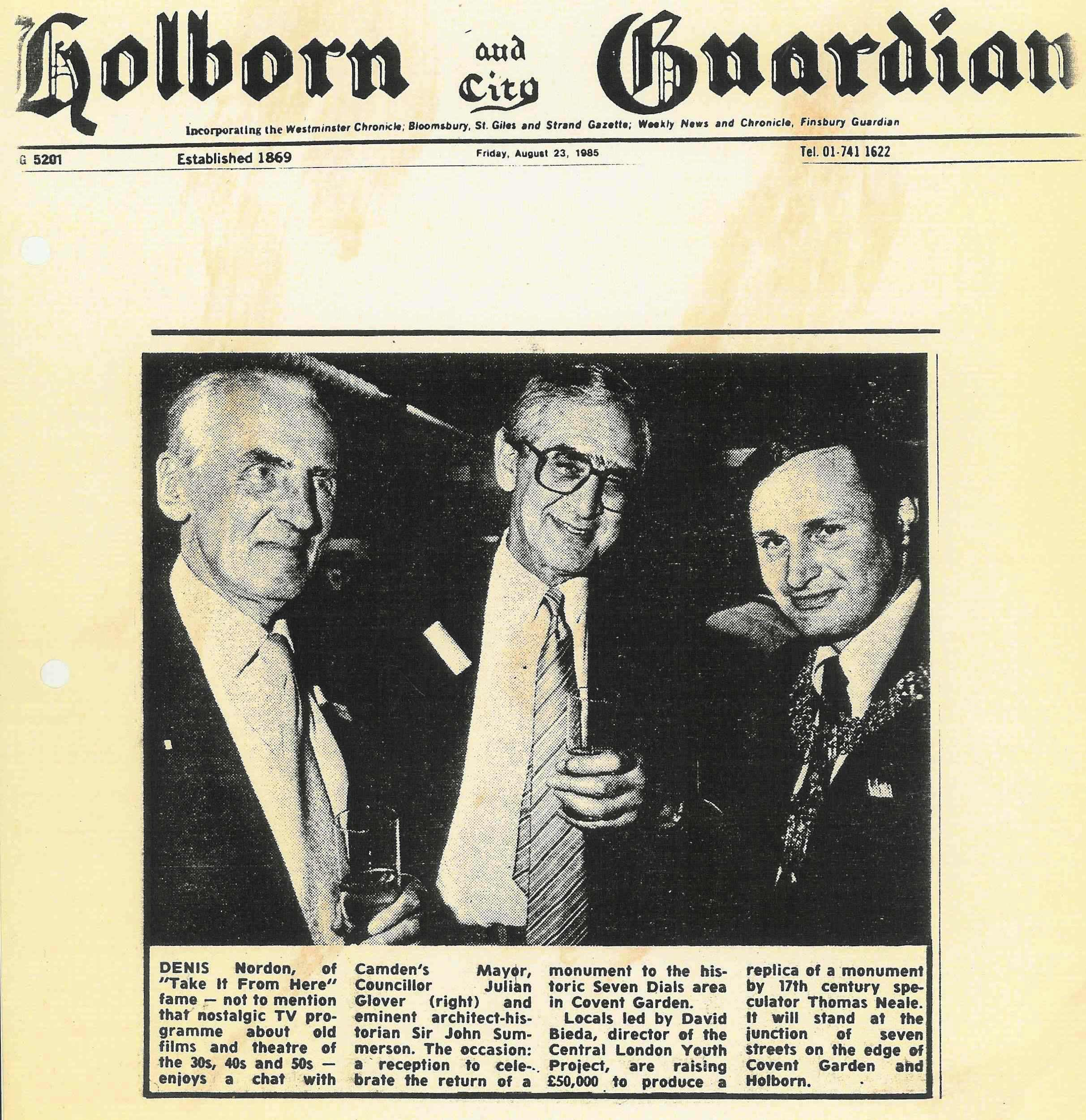 23 Aug. 1985 – Holborn and City Guardian : Denis Nordon, Julian Glover and Sir John Summerson at the reception for the return of the Seven Dials monument.