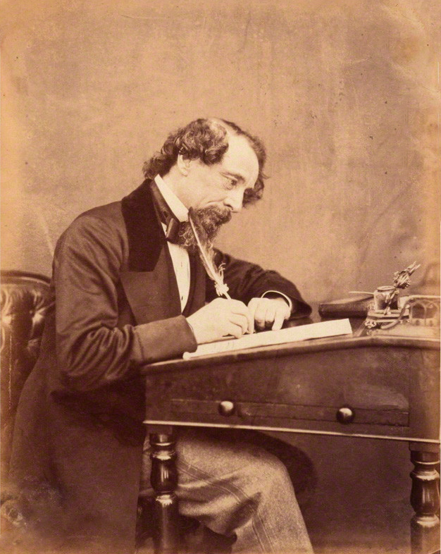 Charles Dickens at his desk by Watkins 1858