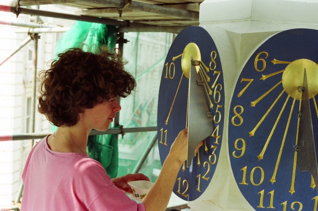 Caroline Webb touching up the dials in situ prior to the unveiling by Her Majesty Queen Beatrix of the Netherlands and Prince Claus in 1989.